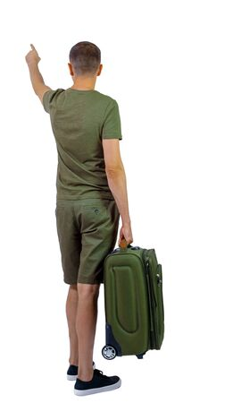 Back view of pointing man with suitcase. Rear view people collection. backside view of person. Isolated over white background. A guy in shorts and sneakers with a suitcase.