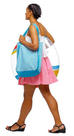 Side view of an African-American with a beach bag that goes to the side. backside view of person. Rear view people collection. Isolated over white background. Imagens