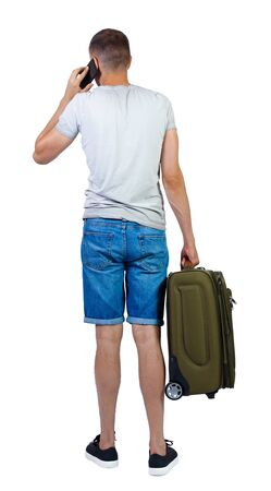 Back view of man in shorts with suitcase talking on the phone. Standing young girl. Rear view people collection. backside view of person. Isolated over white background. A guy in shorts came to the resort.