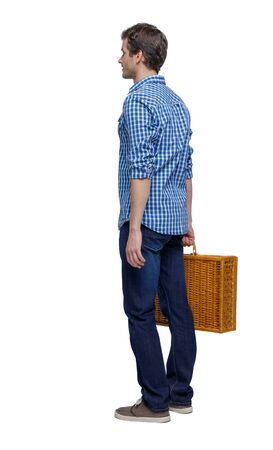 Back view of a man walking with a picnic bag. backside view of person. Rear view people collection. Isolated over white background. Stylish guy with a woven suitcase is worth Stock Photo
