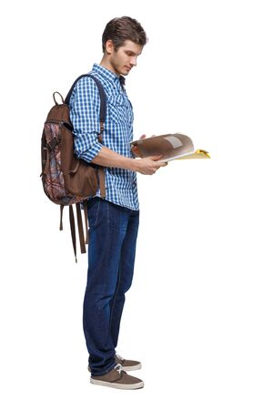 Side view of a student. guy with the backpack and textbooks. Rear view people collection. backside view of person. Isolated over white background. Young student with a backpack leafing through a notebook.