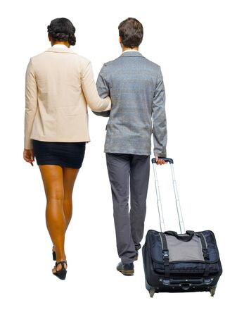 Back view of interracial going couple with suitcase. Rear view people collection. backside view of person. Isolated over white background. A couple of businessmen goes into the distance.