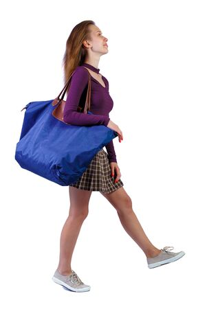 Side view of walking woman with blue bag. backside view of person. Rear view people collection. Isolated over white background.