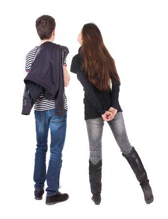 Rückansicht des Paares. schönes freundliches Mädchen und Kerl zusammen. Rückansicht Menschen Sammlung. Rückansicht der Person. Getrennt über weißem Hintergrund.