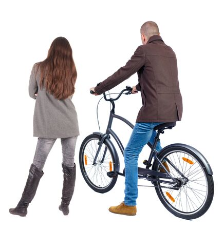 Back view of couple in winter jacket. man on a bicycle and a woman. Rear view people collection. backside view of person. Isolated over white background.