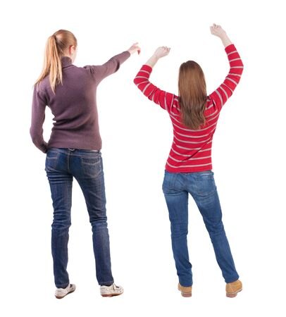 Back view of two pointing young girl in sweater. Rear view people collection. backside view of person. beautiful woman friends showing gesture. Rear view. Isolated over white background. Standard-Bild - 139603239