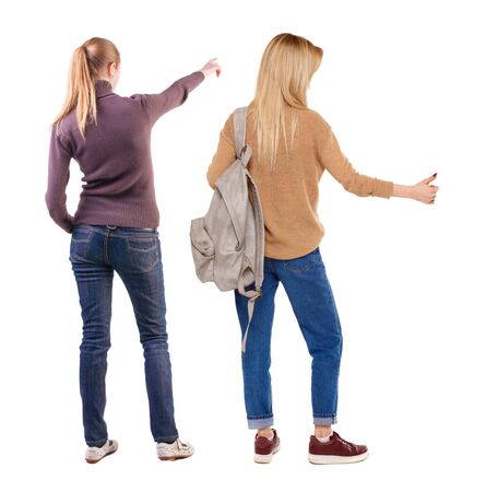 Back view of two pointing young girl in sweater. Rear view people collection. backside view of person. beautiful woman friends showing gesture. Rear view. Isolated over white background. Standard-Bild - 139603070