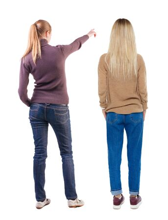 Back view of two pointing young girl in sweater. Rear view people collection. backside view of person. beautiful woman friends showing gesture. Rear view. Isolated over white background. Standard-Bild - 139603212