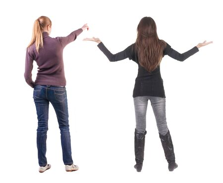 Back view of two pointing young girl in sweater. Rear view people collection. backside view of person. beautiful woman friends showing gesture. Rear view. Isolated over white background. Standard-Bild - 139603083