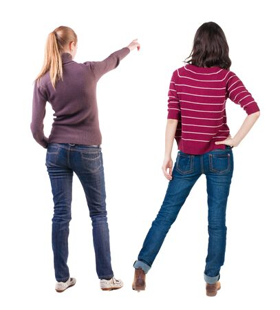 Back view of two pointing young girl in sweater. Rear view people collection. backside view of person. beautiful woman friends showing gesture. Rear view. Isolated over white background. Standard-Bild - 139603113