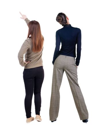 Back view of two pointing young girl in sweater. Rear view people collection. backside view of person. beautiful woman friends showing gesture. Rear view. Isolated over white background. Standard-Bild - 139603086