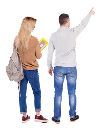 Back view of couple couple in sweater pointing. beautiful friendly girl and guy together. Rear view people collection. backside view of person. Isolated over white background. Imagens
