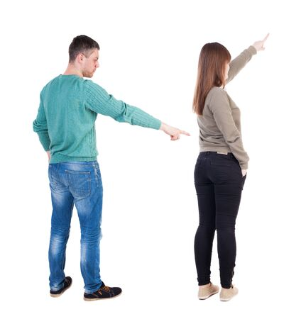 Back view of couple in sweater pointing. Rear view people collection. backside view of person. Isolated over white background. Imagens