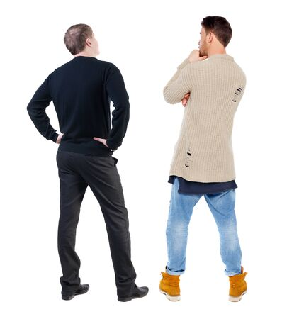 Back view of two man in sweater pointing. Rear view people collection. backside view of person. Isolated over white background.