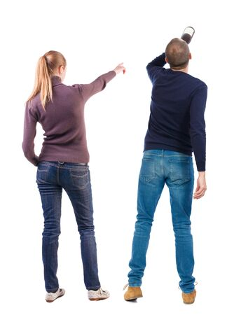 Back view of couple in sweater pointing. Rear view people collection. backside view of person. Isolated over white background. Zdjęcie Seryjne