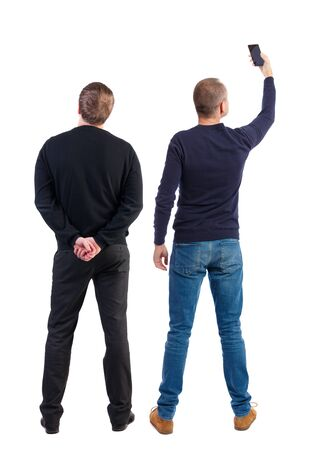Back view of two man in sweater with mobile phone. Rear view people collection. backside view of person. Isolated over white background.