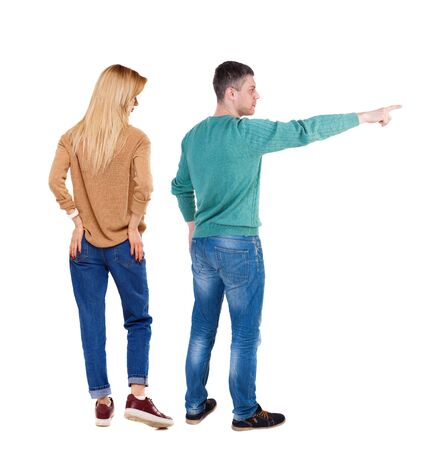 Back view of couple in sweater with mobile phone. beautiful friendly girl and guy together. Rear view people collection. backside view of person. Isolated over white background.