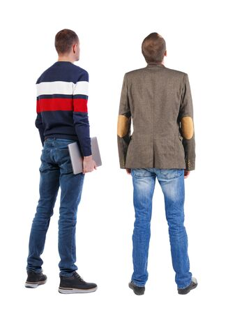 Back view two man in sweater with laptop. Rear view people collection. backside view of person. Isolated over white background. Guys looking forward 스톡 콘텐츠