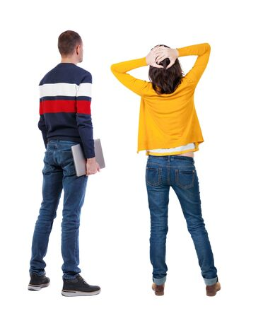 Back view couple with laptop in sweater. beautiful man and woman. Rear view people collection. backside view of person. Isolated over white background.