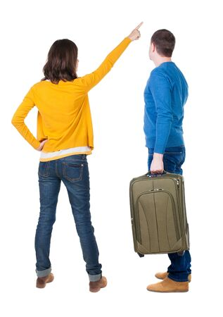 young couple in sweater traveling with suitcas. Back view. Rear view people collection. backside view of person. Isolated over white background.
