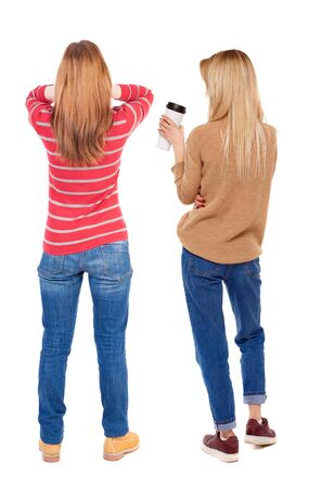 Back view of two woman in sweater. Rear view people collection. backside view of person. Isolated over white background.