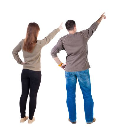 Back view of couple in sweater with mobile phone. beautiful friendly girl and guy together. Rear view people collection. backside view of person. Isolated over white background. Stockfoto