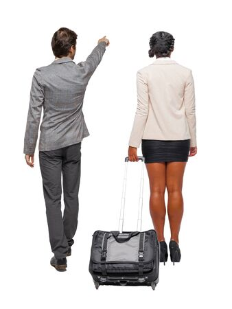 Back view of two business people in suit pointing. Business team. traveling with suitcas. Back view. Rear view people collection. backside view of person. Isolated over white background. 版權商用圖片