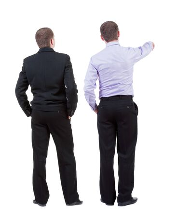 Back view of two business men in suit pointing. Rear view people collection. backside view of person. Isolated over white background. Imagens