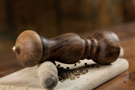 Black pepper with vintage mill Stockfoto