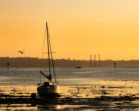 yacht at low tide sunset