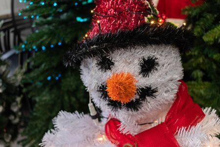 A christmas snowman decoration made of tinsel