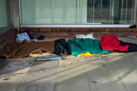 Sleeping bags on the ground laid down by rough sleepers or homeless people