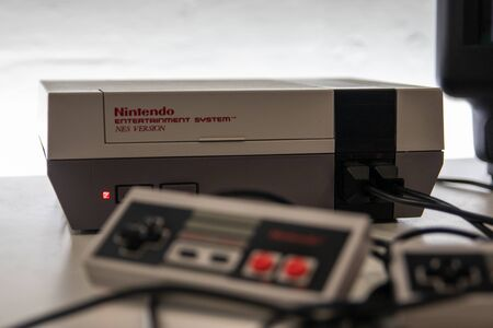 An original Nintendo Entertainment system and controller also know as the NES a retro gaming console released in 1983