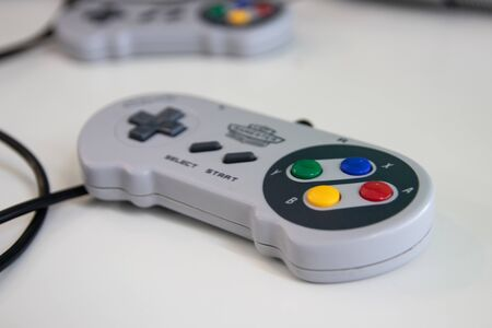 A super Nintendo games console controller which was part of the games console known as a SNES released in 1990