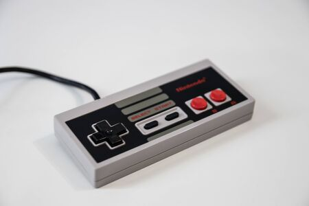 A Nintendo Games console controller for a nintendo entertainment system or NES released in 1983 新聞圖片