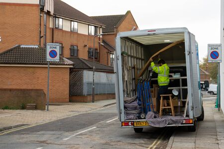 11/05/2019 Portsmouth, Hampshire, UK a removal man in a removal van moving furniture