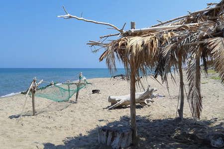 Beach hut and hammock built on the beach