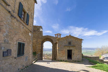 View of a medieval glimpse with entrance to the village and church