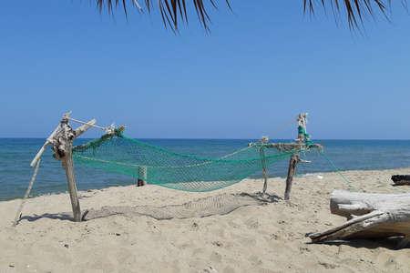 Hammock built on the beach near the sea