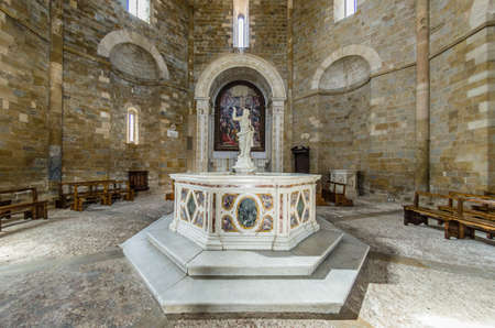 Statue of the baptismal font in the baptistery in Volterra