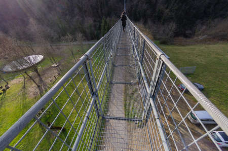 Suspension bridge walkway seen from above in the foreground