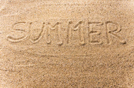 """Background with text """"summer"""" written in the sand"""
