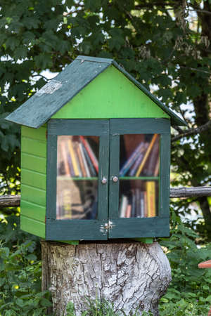 Small street library for free book exchange Archivio Fotografico