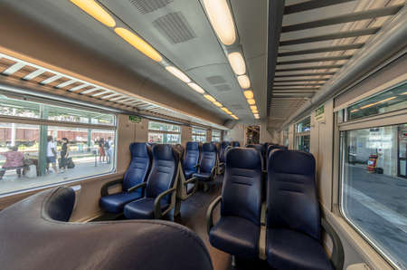 View of the interior of a train with empty seats