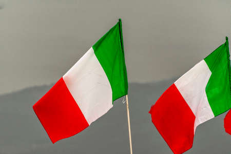 Italian flags flying in the sky