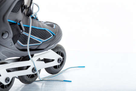Close up view, on white, of inline skate  photo