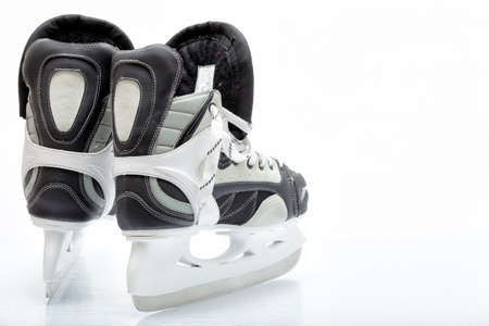 Close up view, on white, of ice skate for hockey of freestyle use photo