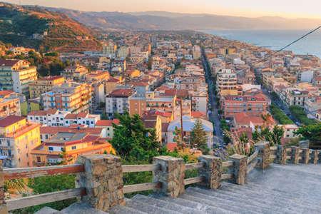 known: Wonderful panorama of Capo dOrlando (Italy) during sunset. Capo dOrlando is a comune in the province of Messina, Sicily, Italy well known for summer seaside-related activities due to its beautiful coastline Stock Photo