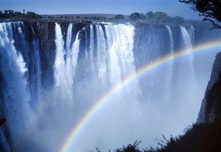 Rainbow on the Victoria falls, Zimbabwe, Africa 스톡 콘텐츠
