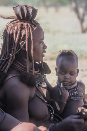 Himba People, Epupa Falls, Kunene, Kaokoland, Namibia, Africa Stock fotó - 115643740